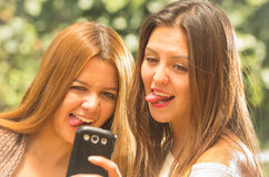 Girls outdoors posing for selfie Royalty Free Stock Photos