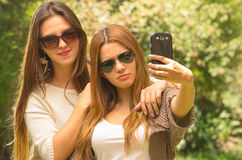 Girls outdoors posing for selfie Stock Photography