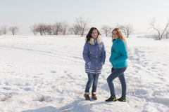 Girls outdoors in winter day Royalty Free Stock Images