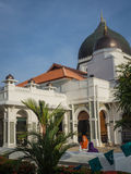 Girls outside Masjid Capitan Keling Mosque in Penang. The famous Masjid Capitan Keling in Penang, with two girls in brightly coloured hijab in the foreground Stock Photo