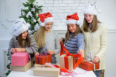 Girls packed Christmas gifts Royalty Free Stock Images