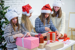 Girls packed Christmas gifts Stock Photography