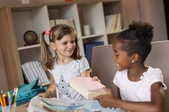 Girls packing school bags royalty free stock photos