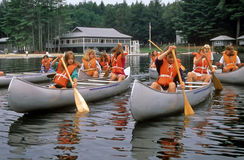 Girls Paddle Canoes Royalty Free Stock Photo