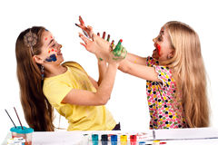 Girls paint each other's colors Royalty Free Stock Photos