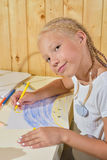 Girls paint pencils Stock Photography