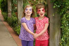 Girls with Painted Faces Stock Images
