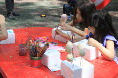Girls painting easter eggs Royalty Free Stock Image