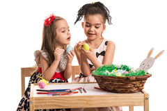 Girls painting Easter eggs Stock Photography