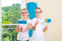 Girls painting a wall in the family home Royalty Free Stock Photo