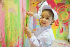 Girls painting wall Royalty Free Stock Photos