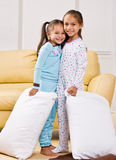 Girls in pajamas in living room Stock Images