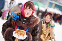 Girls   with pancake during  Shrovetide Royalty Free Stock Photo