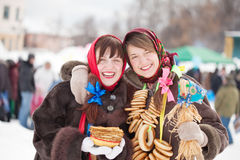 Girls with pancake during  Shrovetide Stock Photos