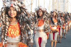 Girls in a parade. Picture of Girls in a parade with chicken headdress stock images
