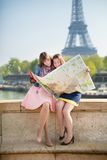 Girls in Paris looking for direction Royalty Free Stock Images