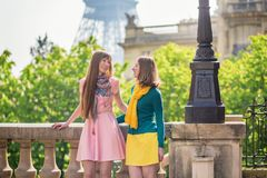 Girls in Paris near the Eiffel tower Royalty Free Stock Photography