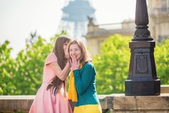 Girls in Paris near the Eiffel tower Stock Photos