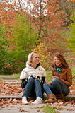 Girls in park. Young pretty girls laughing at the autumn park Royalty Free Stock Photos