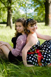 Girls in a park Stock Images