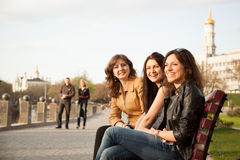 Girls in the Park. Girls sitting on a bench in city park Stock Image