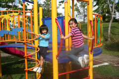 Girls at the park. Happy girls at the playground in the park Royalty Free Stock Photo