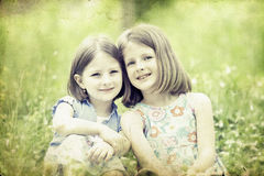 Girls in the park-vintage photo Royalty Free Stock Photo