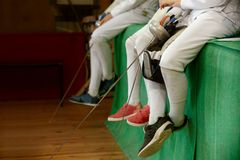 Girls participants in fencing competitions on swords rest between competitions. royalty free stock images