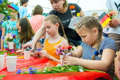 Girls participating at floristic workshop Stock Image