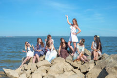 The girls` party on the beach. Eight young women near the sea royalty free stock photos