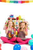 Girls with party blowers Royalty Free Stock Image
