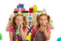 Girls with party blowers Stock Photography