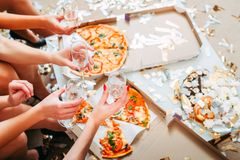 Girls party celebration eating pizza drinking royalty free stock images