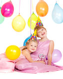 Girls in party hats Stock Images