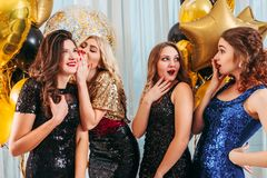 Girls party occasion whispering surprising news stock photography