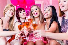 Girls partying in night club. Women partying with champagne in night club stock photography