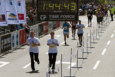 Girls passes the finish line Royalty Free Stock Photo