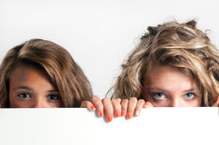Girls Peeping Royalty Free Stock Photos