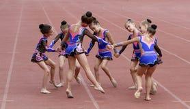 Girls perform on the opening ceremony. Unidentified girls perform on the opening ceremony of the international athletic meet between Ukraine, Turkey, Belarus on Royalty Free Stock Photography