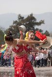 Girls performing in the water-splashing festival Royalty Free Stock Photography
