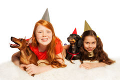 Girls and pets having fun on birthday party Stock Photos