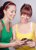 Girls with phone Royalty Free Stock Photography