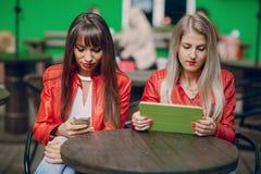 Girls with phone Stock Photos