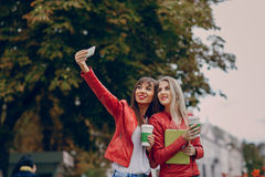 Girls with phone Stock Photography