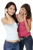 Girls and Phones 1. Two pretty young women on the phone Stock Photo