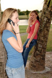 Girls on phones Stock Images