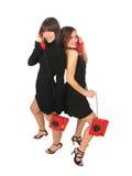 Girls with phones Stock Photos