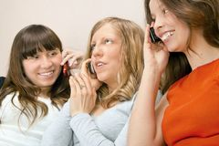 Girls With Phones. Young girls talking with phones Royalty Free Stock Photos