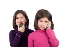 Girls with phones Stock Image