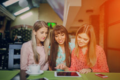 Girls with phones Royalty Free Stock Photography
